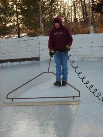 Grooming the rink with his homemade \