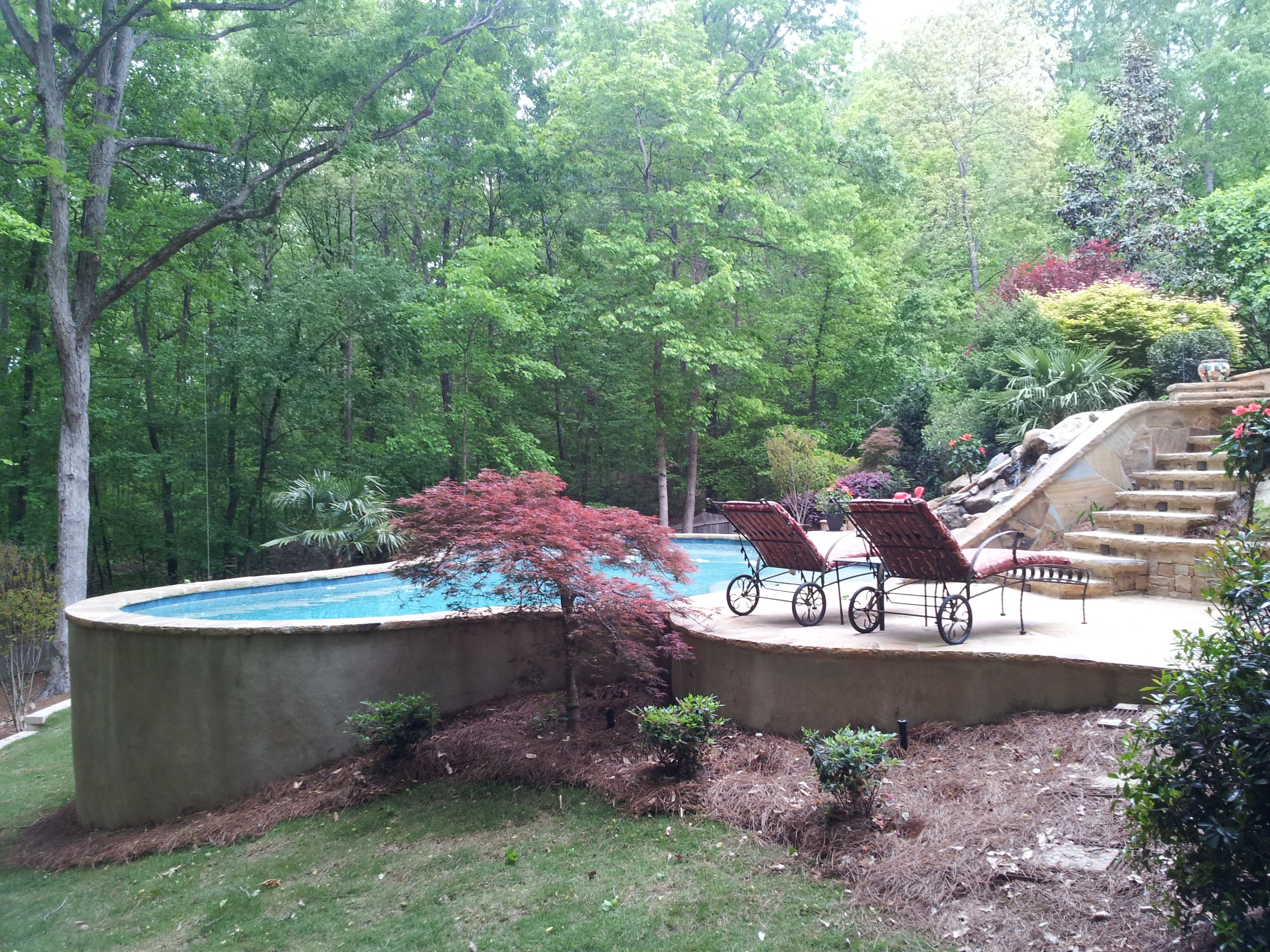 free form pool held by concrete retaining wall