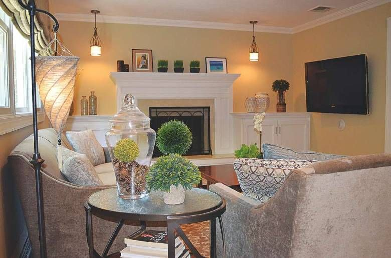 In This Living Room Designedcozette Brown The Tv Is Installed Gorgeous Living Room Television Design Inspiration Design