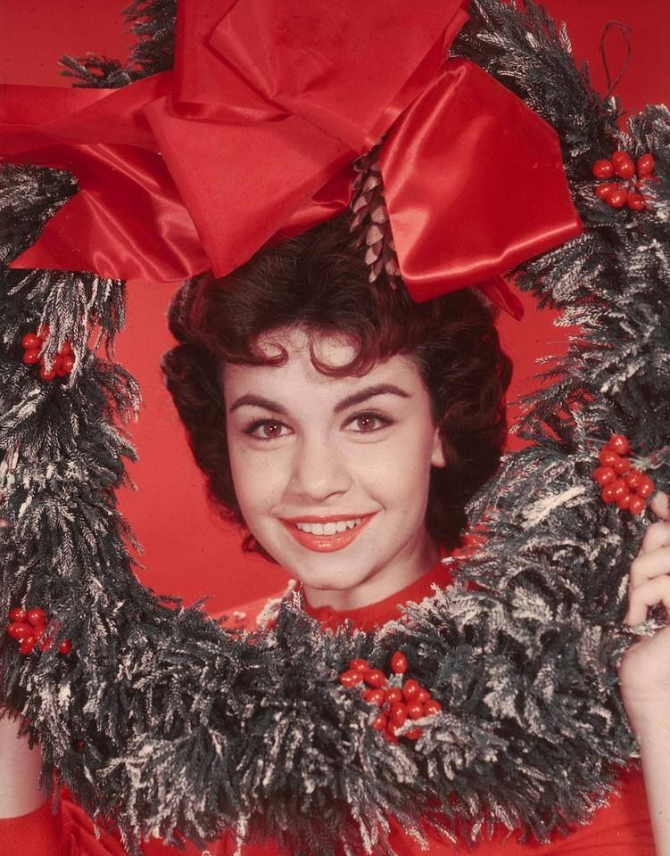 Annette Funicello poses in a Christmas wreath, circa 1955.