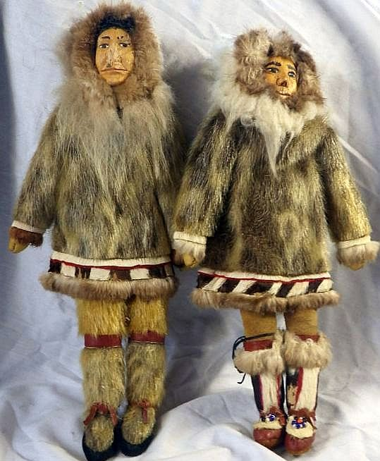 Vintage Inuit Eskimo Doll with Traditional Fur Clothing. Handmade. Wood carved face.