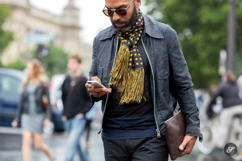 Men wearing scarf and clutch on a streetstyle photo taken