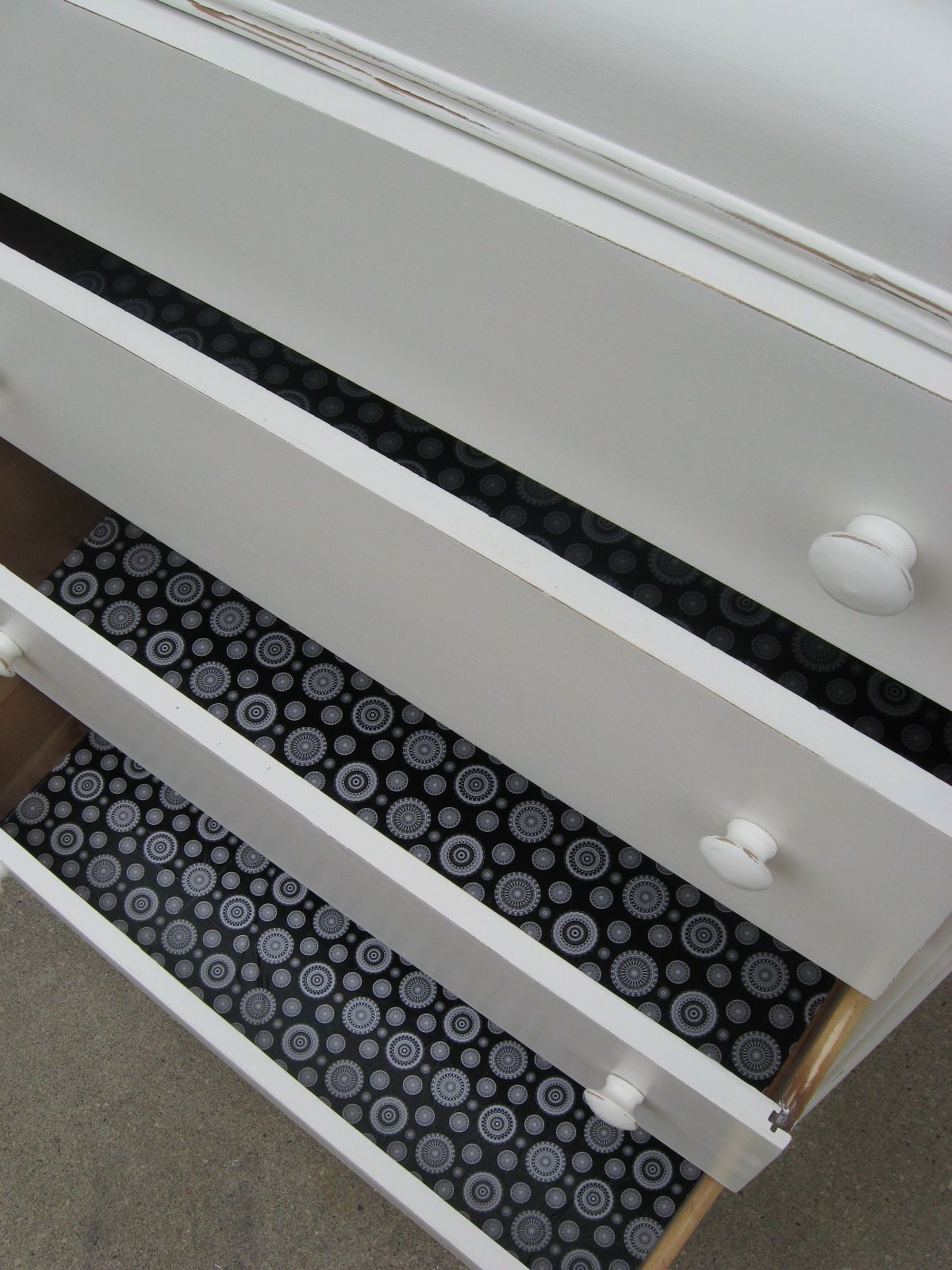 wallpaper in drawers instead of expensive shelf liner. Get