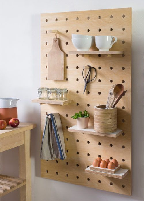 wall mounted kitchen shelves are very versatyle when you put them on a pegboard - Shelterness