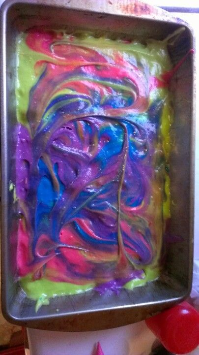 Cake batter with purple pink blue and neon green food coloring ...