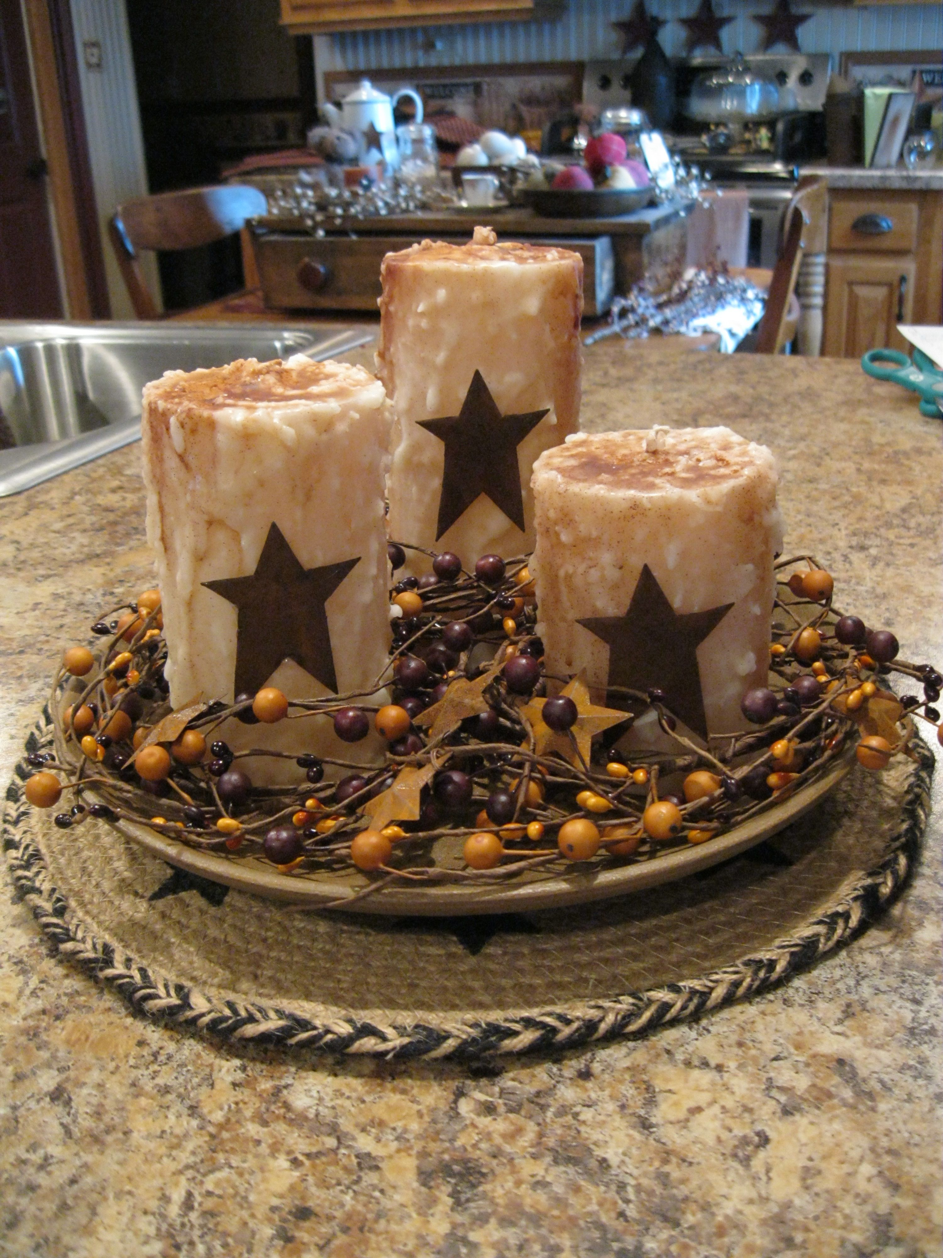 Centerpiece With Rustic Candles And Wood Bowl Primitive Homes Rustic Candles Home Decor