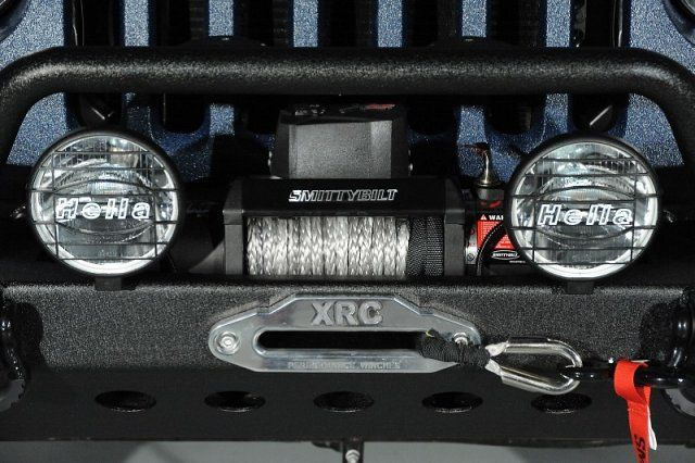 Close up view of the custom XRC winch and Hella off road lights.