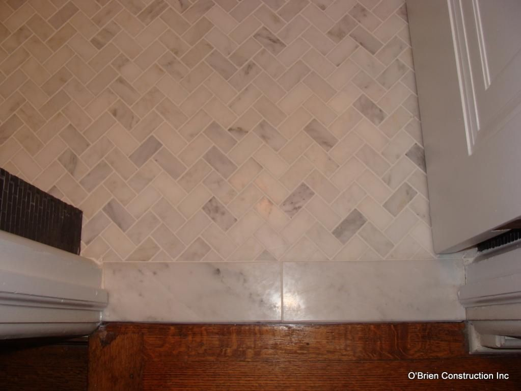 Bathroom threshold question fox and other remodelaholics for Small bathroom herringbone tile
