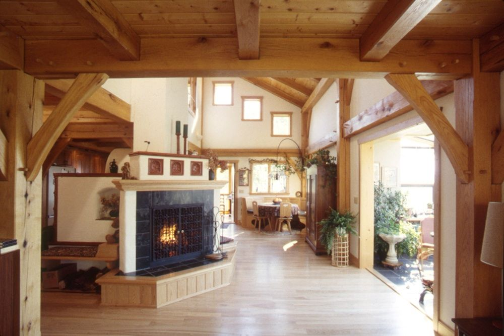 Grand Fireplace W Vaulted Ceilings Beams Open Floor: The Open Floor Plan Of This Oak Timber Frame Home Features