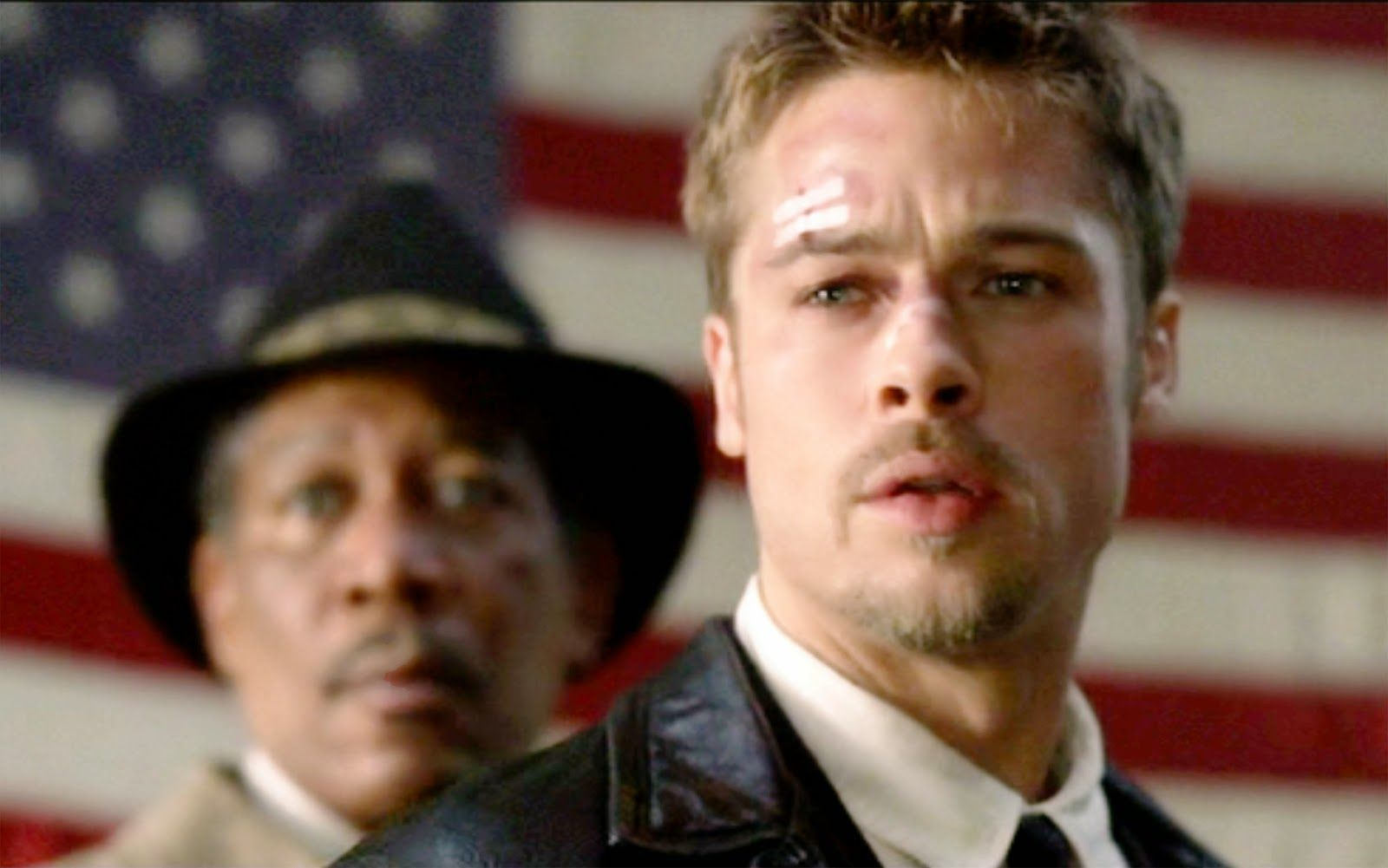 Morgan Freeman (as Detective William Somerset) and Brad Pitt (as Detective David Mills). Theatrical release September 22, 1995. Screen capture. Copyright © 1995 New Line Productions, Inc. Credit: © 1995 New Line Prod. / Courtesy: Pyxurz.