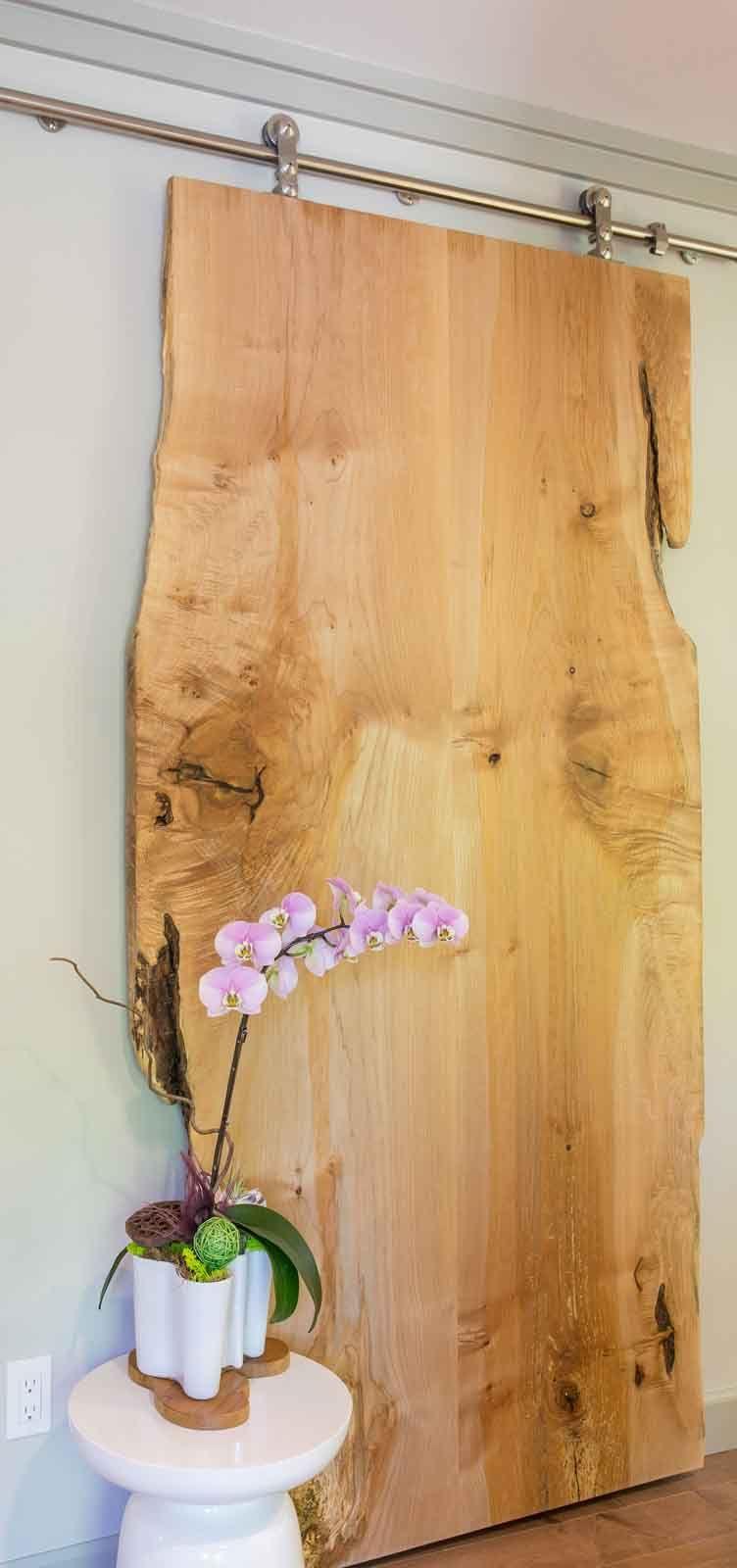 Sliding finished wood slab door in Kirkland, Washington condo retreat - by Amy May, May Designs, Seattle, WA.