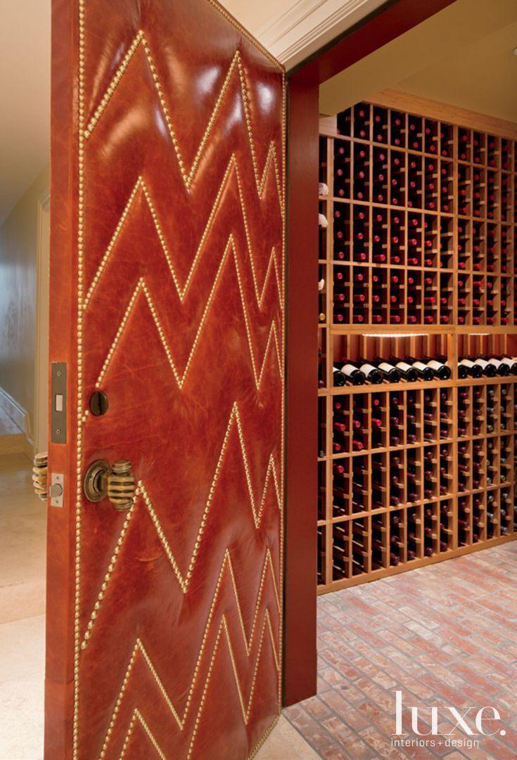 Eclectic Wine Cellar With Leather Door Luxe Interiors Wine Cellar Wine Cellar Door