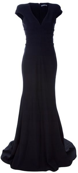 7a45dd29f5 Black floor length silk dress from Alexander McQueen featuring a pleated  rib efffect on the sides of the dress. V neckline