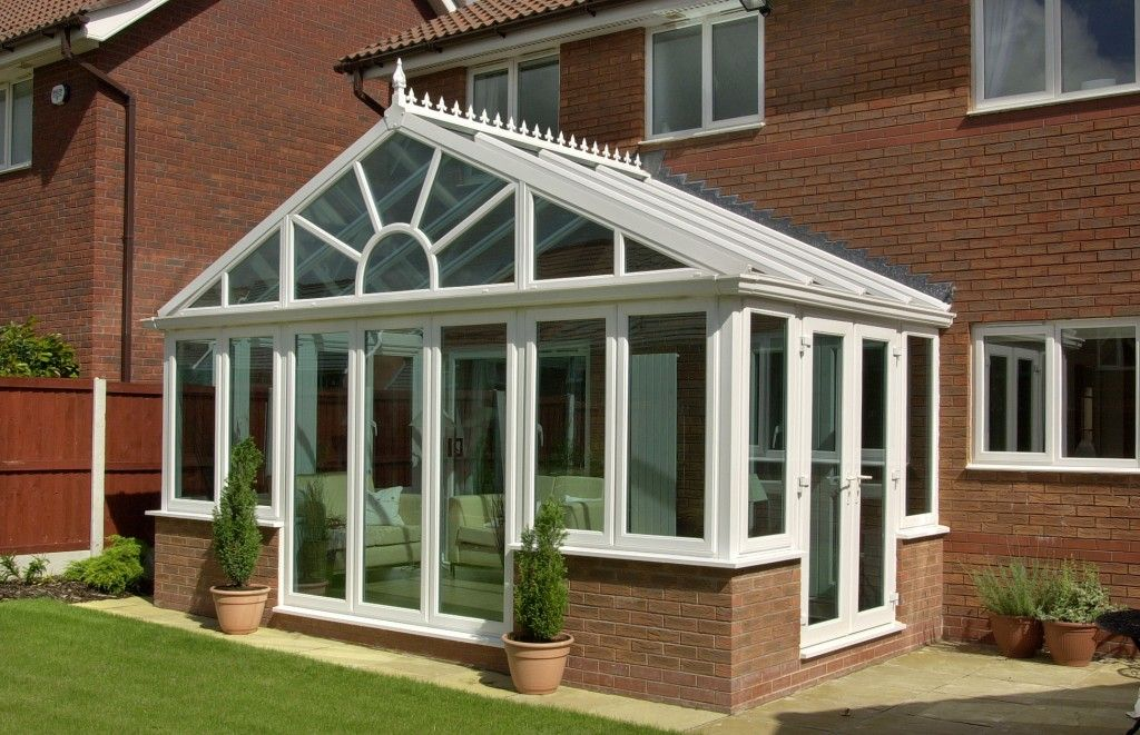 White Gable Conservatory With Brick Corner Half Walls Conservatory Design Conservatory Prices Garden Room Extensions