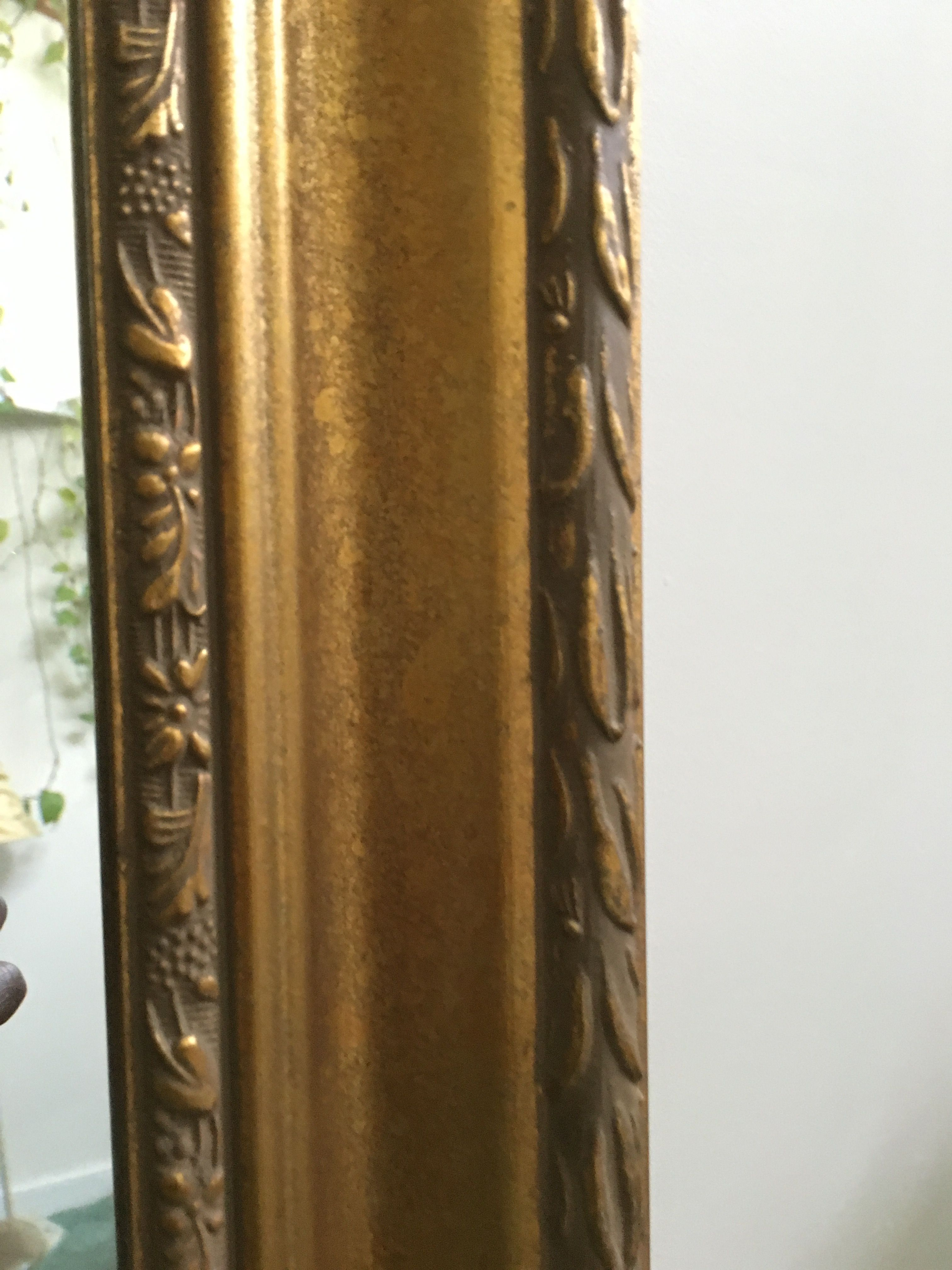 Detail photo of an antique gold mirror