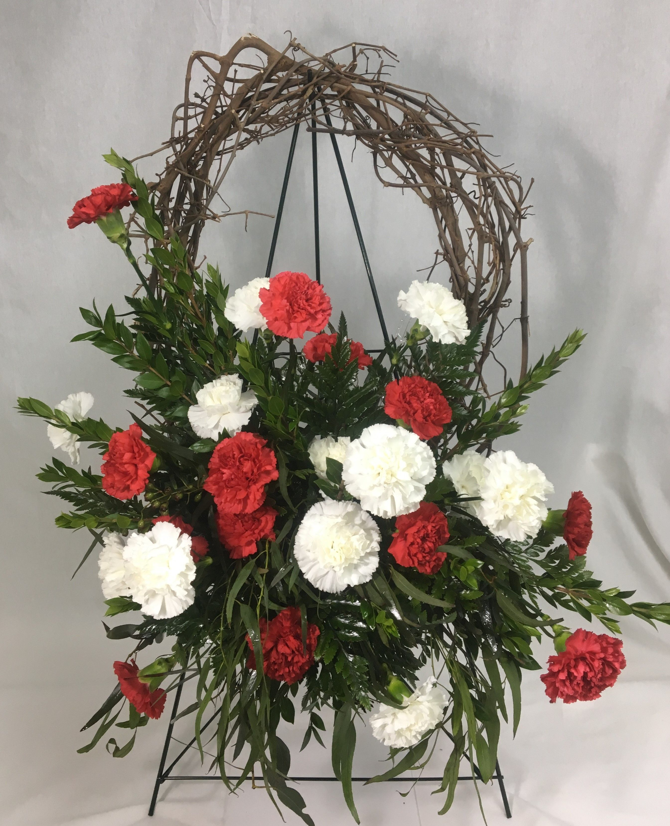 Red and white standard carnations myrtle willow eucalyptus and funeral flowers red and white standard carnations myrtle willow eucalyptus and leather fern attached to izmirmasajfo