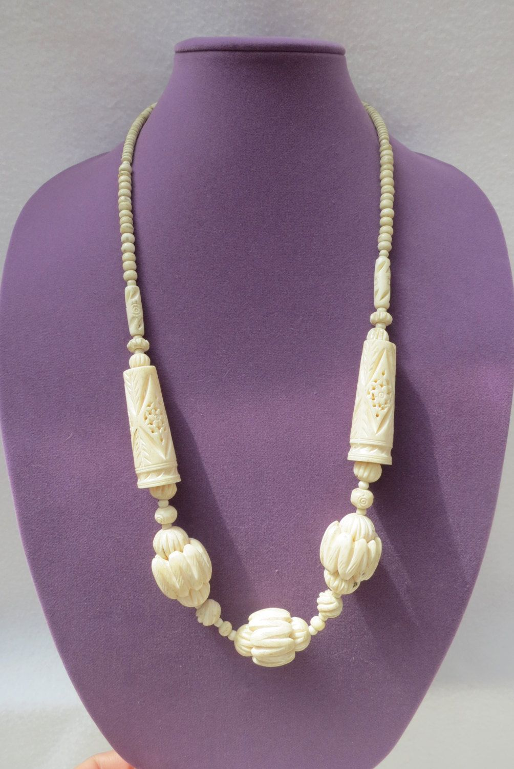 Long beautifully decorated bone necklace by Framarines on Etsy