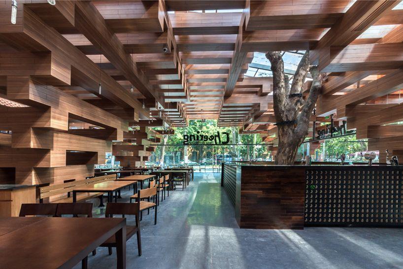 H&P architects brings hanoi street life into tree-lined restaurant