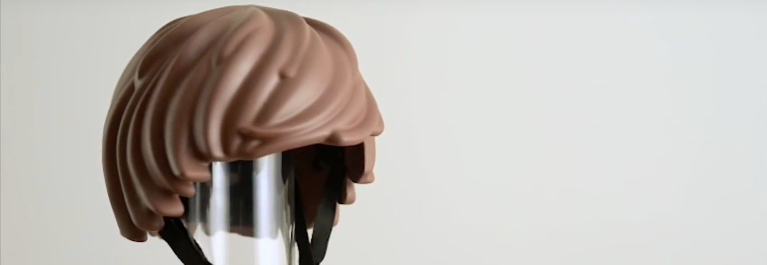 This Playmobil hair helmet was designed to make it easier and fun for kids to be safe while riding their bicycles.