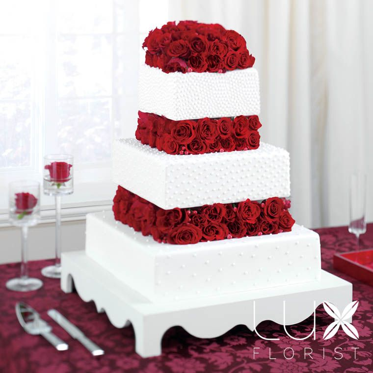 White cake with red flowers in between tiers red wedding white cake with red flowers in between tiers mightylinksfo