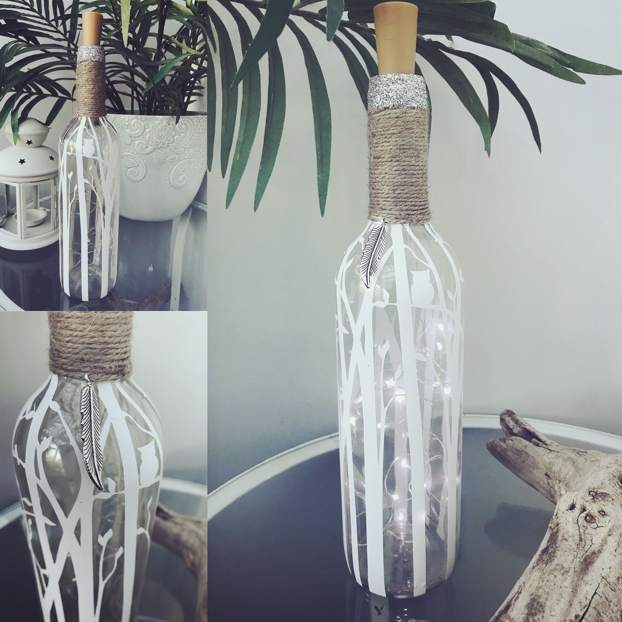 Wine bottle with wire twinkle lights inside. White birth tree ...