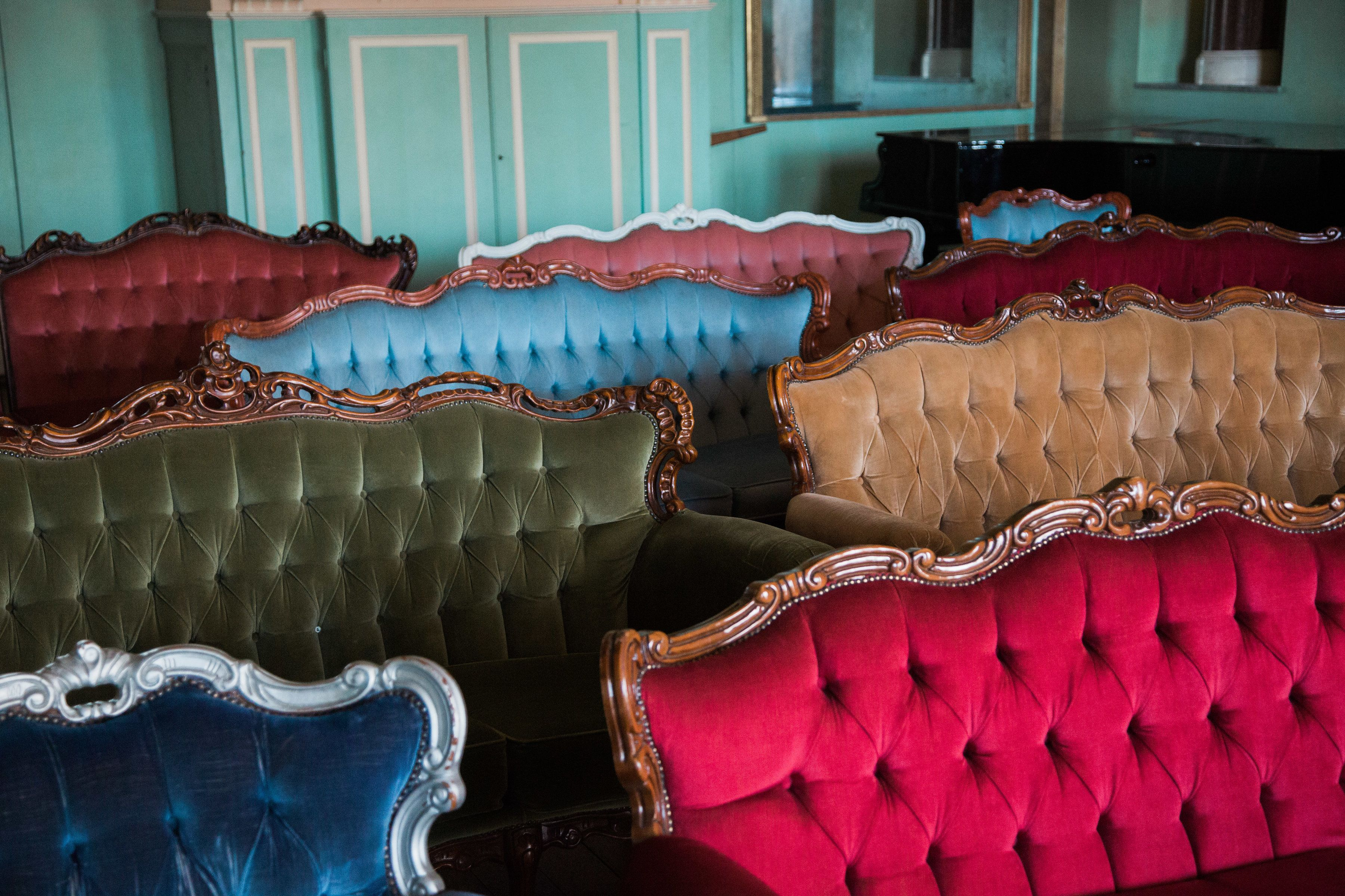 Vintage sofas all in a row at Powderham Castle. Image by