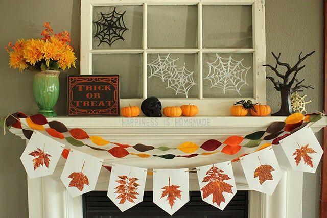 Glitter Glue Spiderwebs on Fall Halloween Mantel Fall decorating