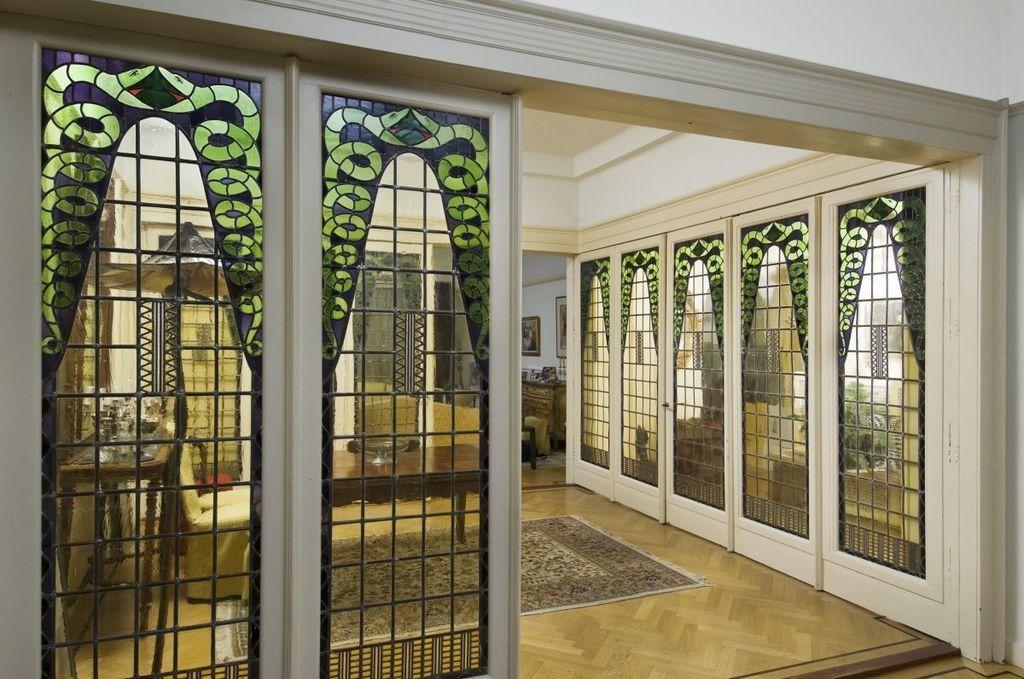 amsterdamse school interieur woonkamer met vouwdeuren