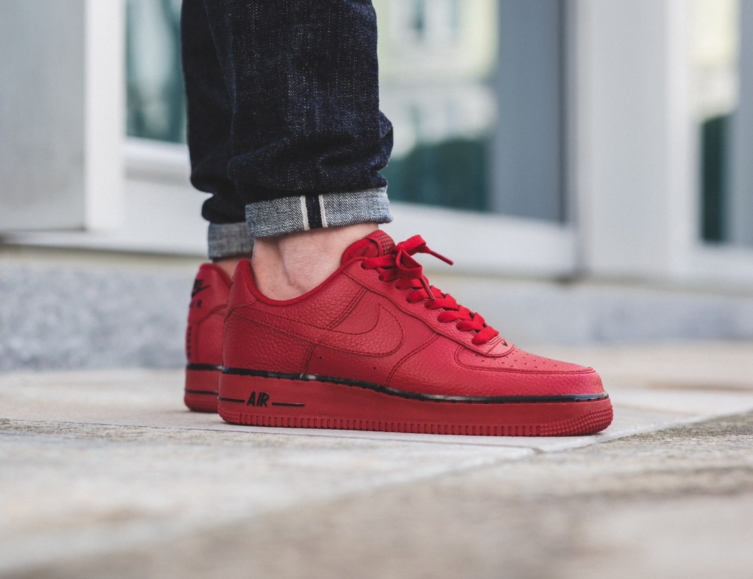 newest 40f22 15aec The Nike Air Force 1 Low in bright Gym Red is showcased in another  perspective.