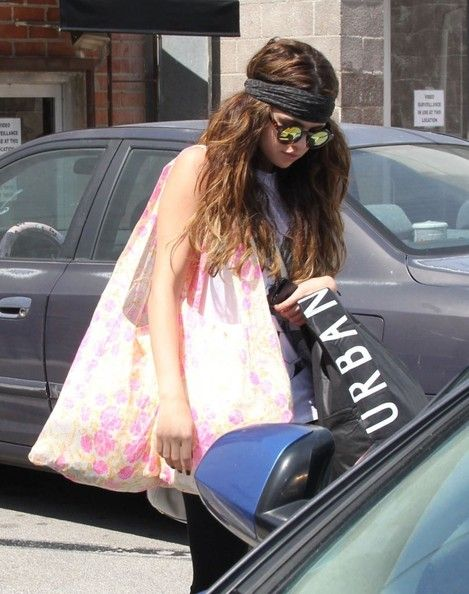 Spring Breakers star Selena Gomez being camera shy while shopping at Urban Outfitters and Free People in Studio City, California on June 1, 2013.