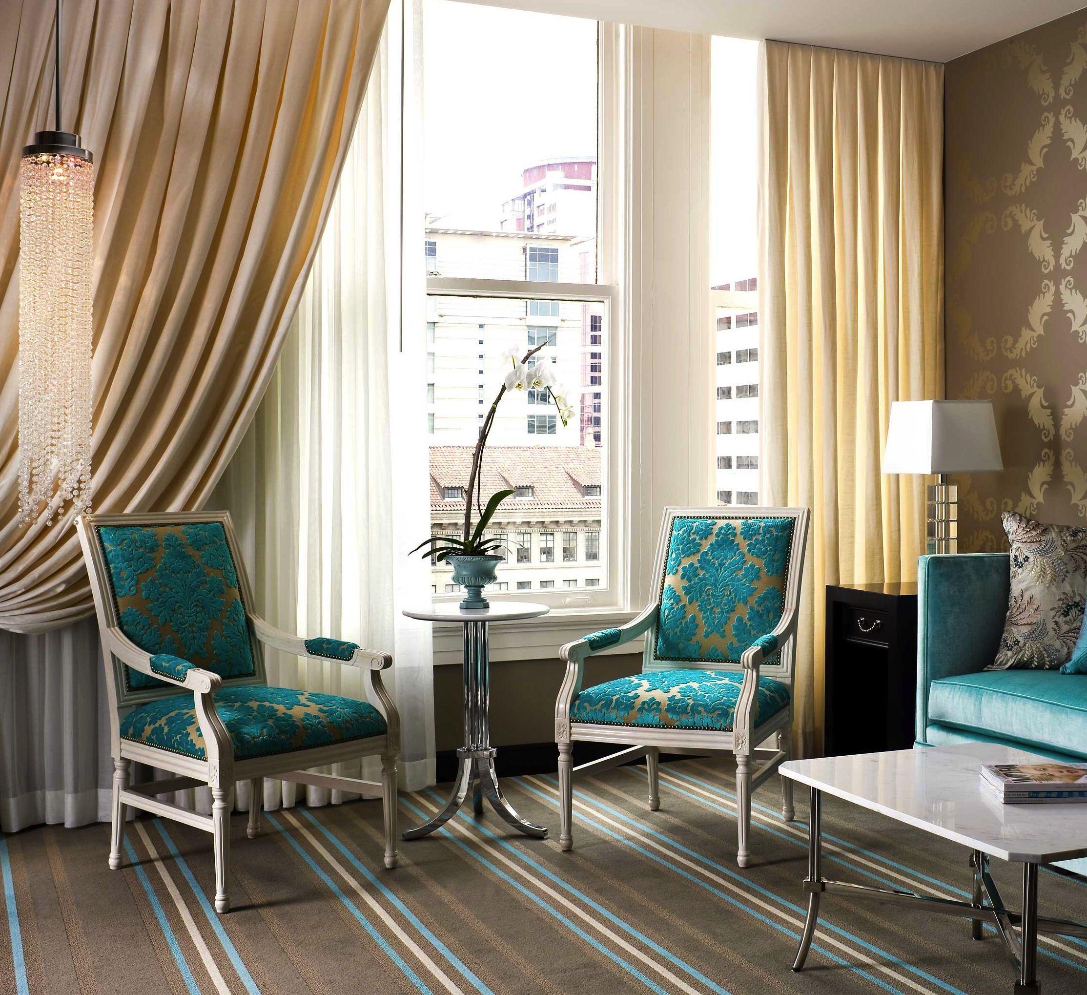 The Nines Portland Oregon Jetsetter Living Room Turquoise Modern Living Room Interior Turquoise Room