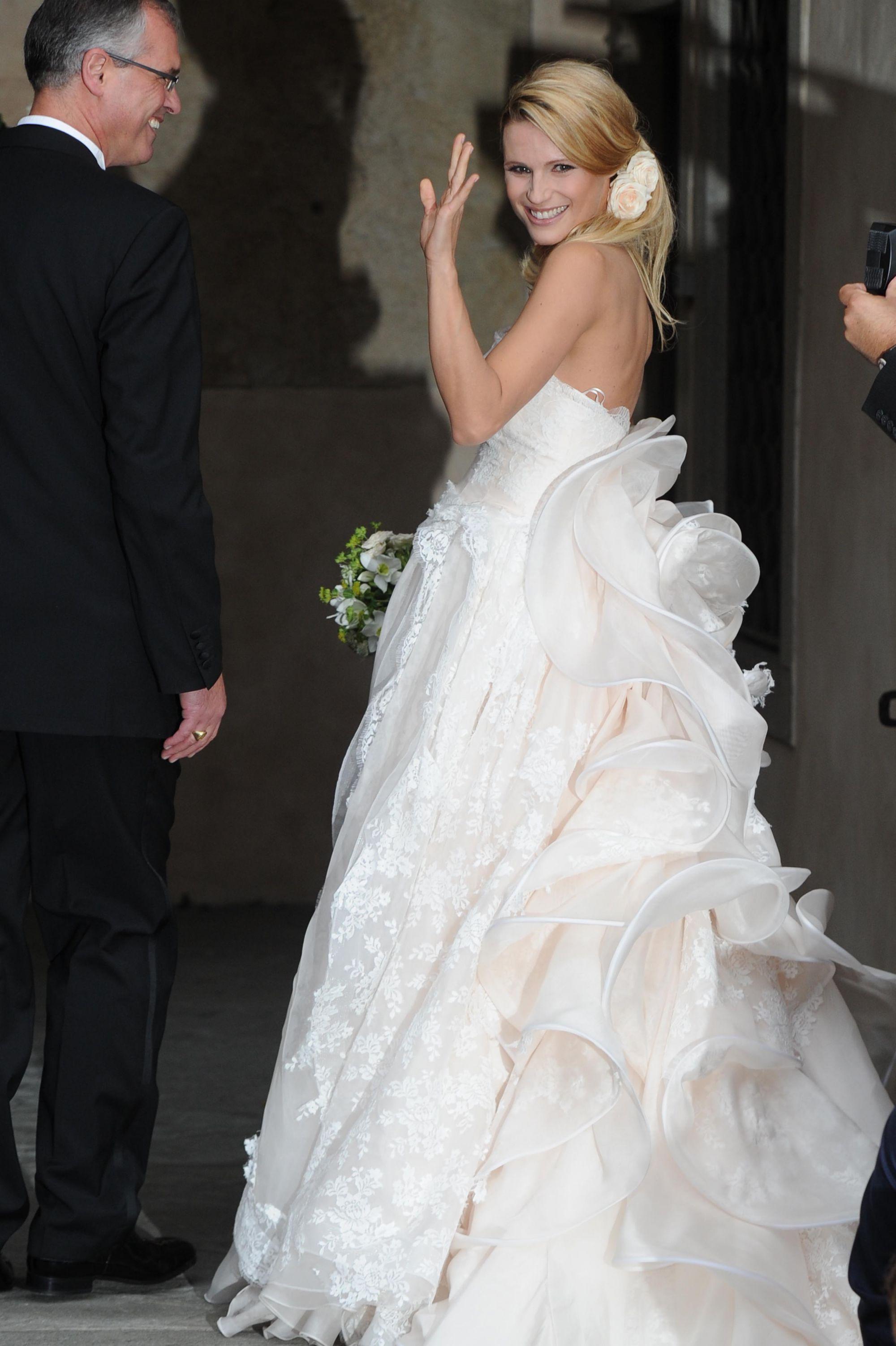 Tomaso Trussardi et Michelle Hunziker - Sortie du mariage de ...
