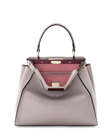 Fendi Peekaboo bicolor leather tote bag. Golden hardware. Leather top handle  with rings  3.3