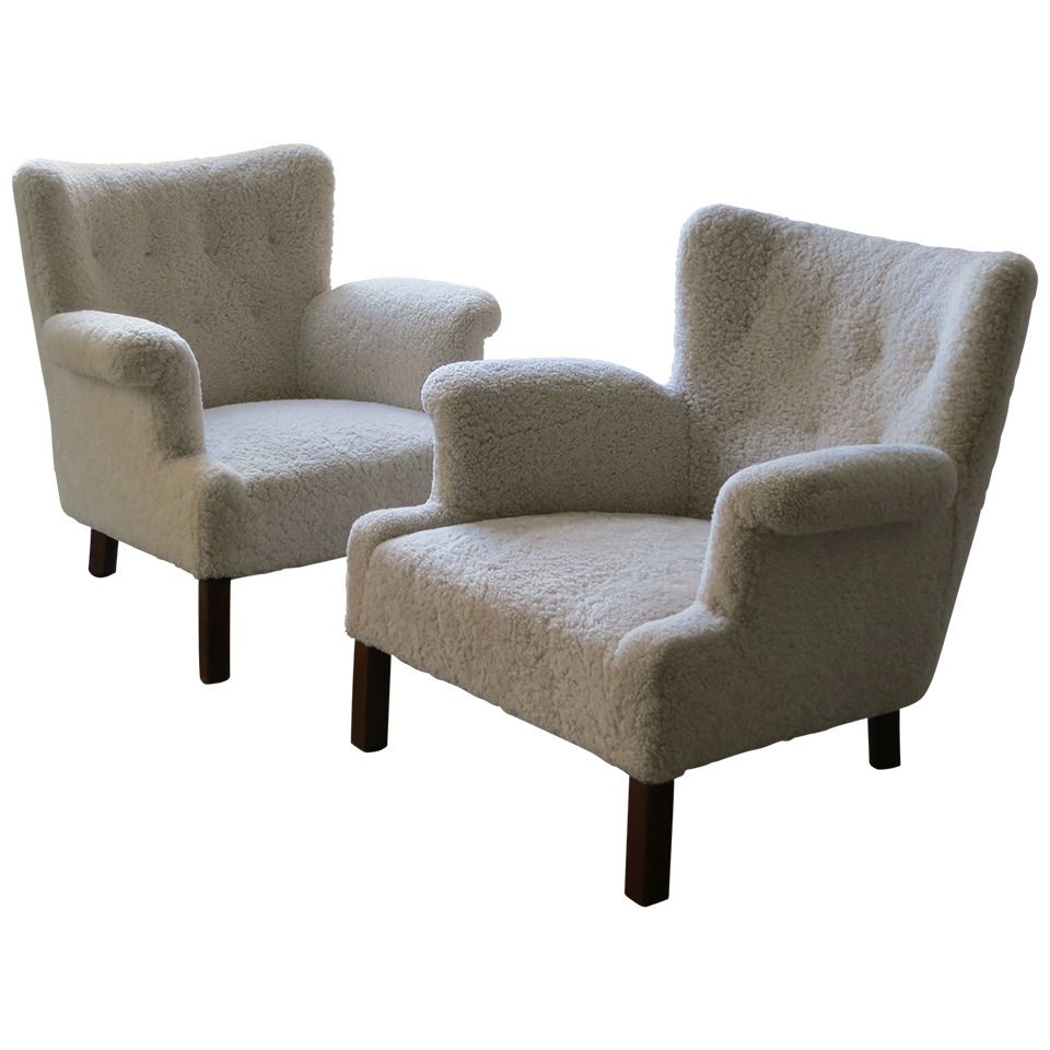 A Pair of Elegant and Refined Sheepskin Lounge Chairs by Orla Mølgaard-Nielsen | From a unique collection of antique and modern lounge chairs at https://www.1stdibs.com/furniture/seating/lounge-chairs/