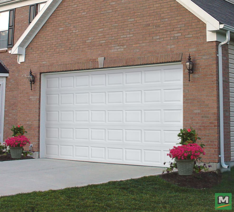 This 16 X 8 Ideal Door White Steel Panel Garage Door Features A Design That Works With Every Home This Three L Garage Door Panels Steel Panels Garage Doors