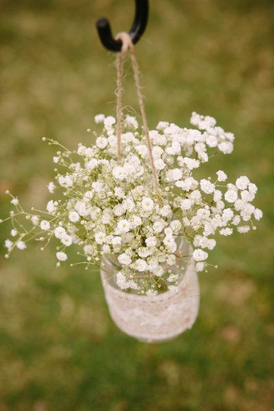 Baby's Breath in mason jars...hang them going down the isle