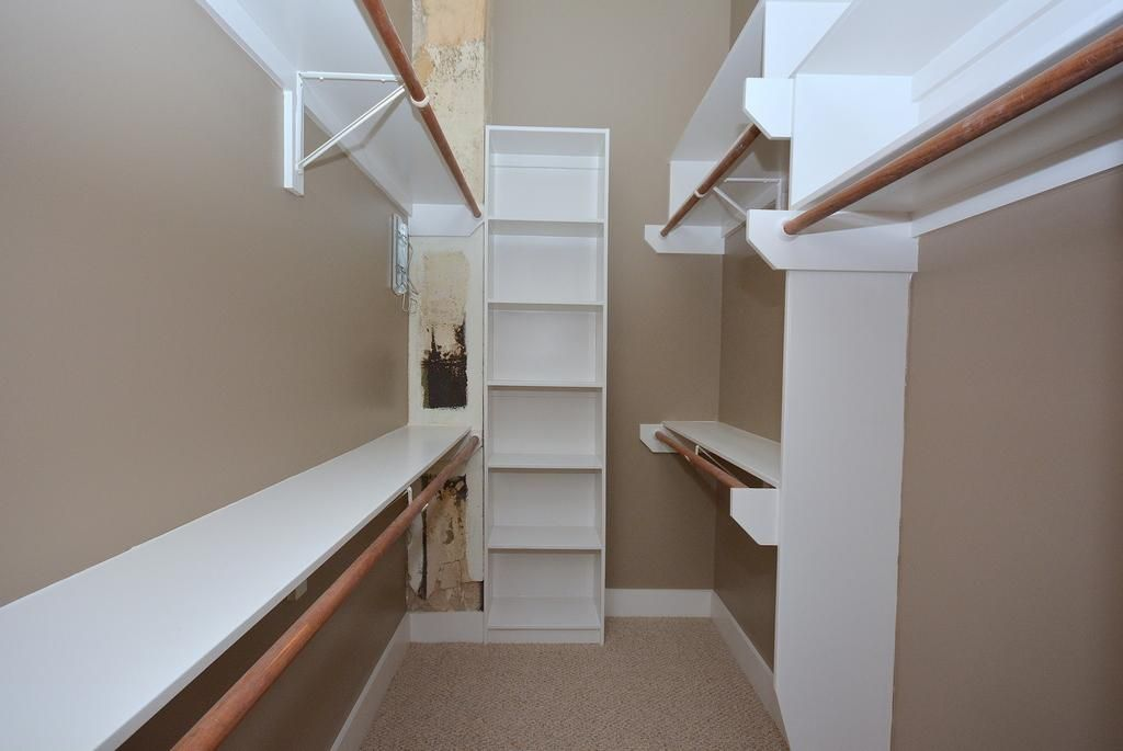 A partial view of the large walk in closet features double for Walk in closet dimensions