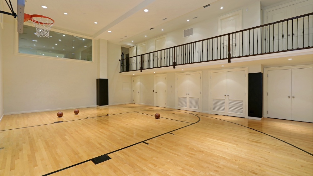 A Basement Basketball Court In A Chicago Home Complete With 16 Foot Ceiling The Home Recently Building A Basement Basement Gym Luxury Homes