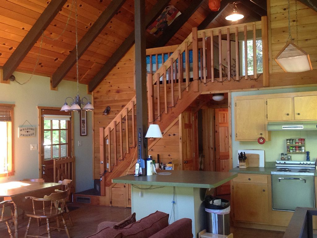 beach pa cottage friendly springtime pet cabins out rate an delaware enjoy in the front fire getaways lake cabin evening sky under river rental starry special