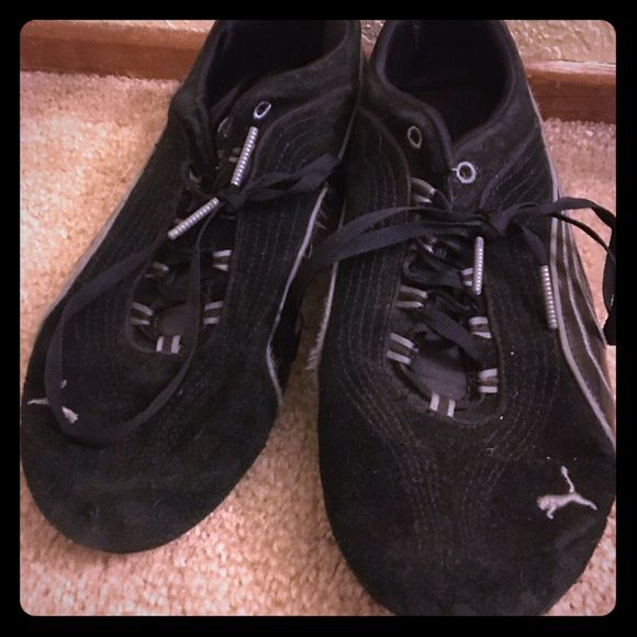 Puma sport shoes Black Puma shoes. Have been used and there are signs of wear and holes Puma Shoes Athletic Shoes