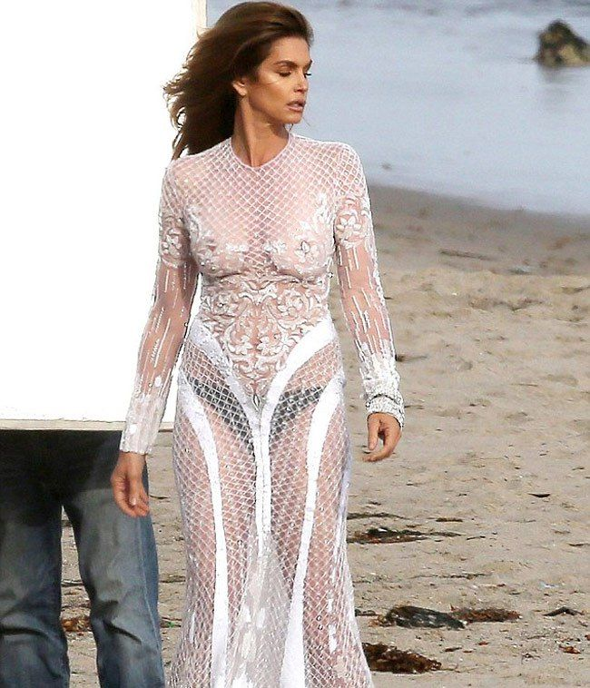 Cindy Crawford Poses in a White See-Through Dress
