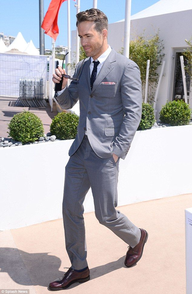 Suited and booted: The actor paired his grey suit with a white ...