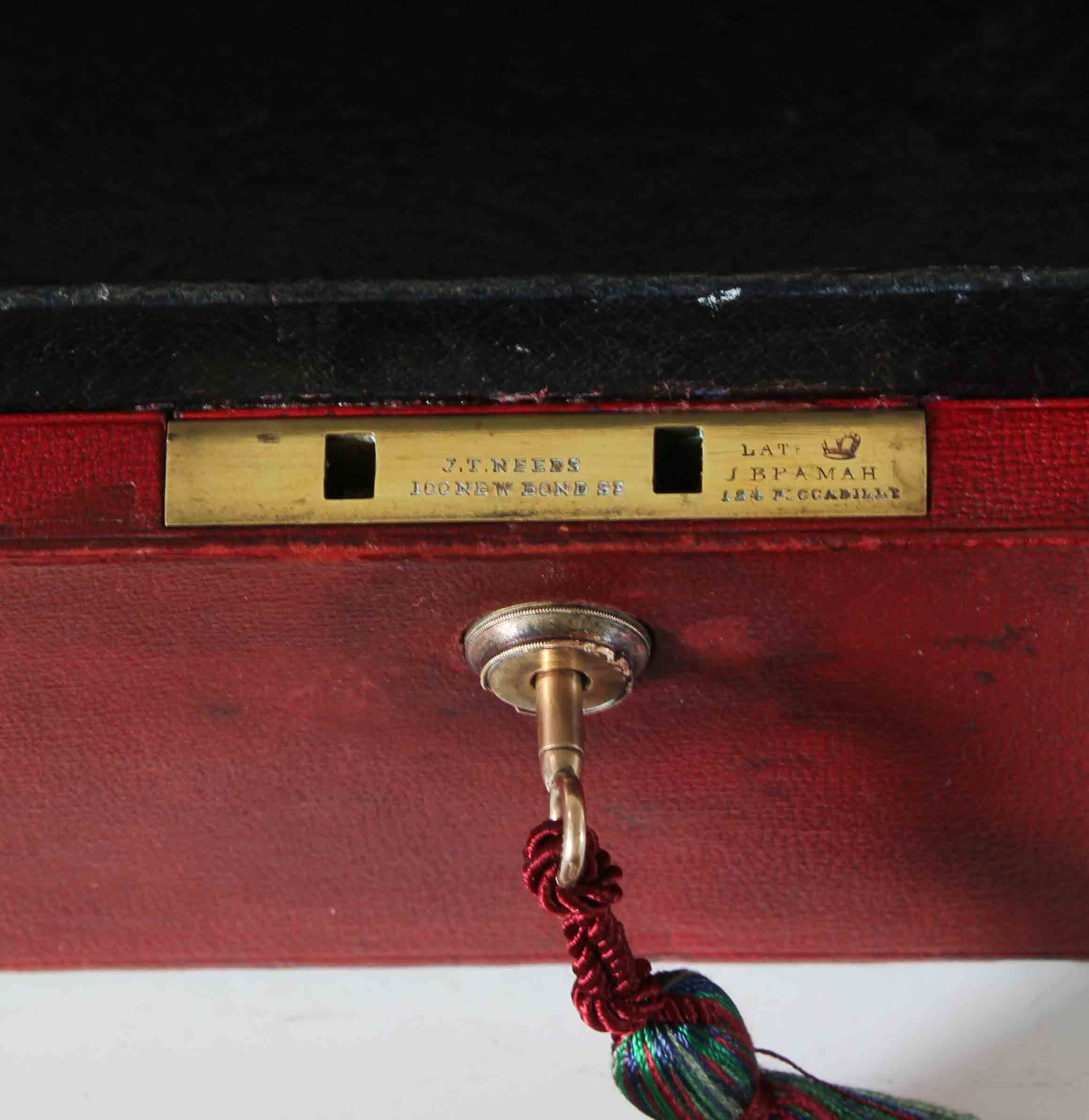 A full size Victorian Red Leather Despatch Box, originally the property of Sir Walter Wragg. KT.DCL.*. The lid with a recessed brass drop handle, the black Morocco leather interior with crossed leather strips inside the lid for holding memoranda etc. The working lock with key stamped with the Royal Crown, and J.T. NEEDS 100 NEW BOND ST., LATE J. BRAMAH 184 PICCADILLY. #despatchbox