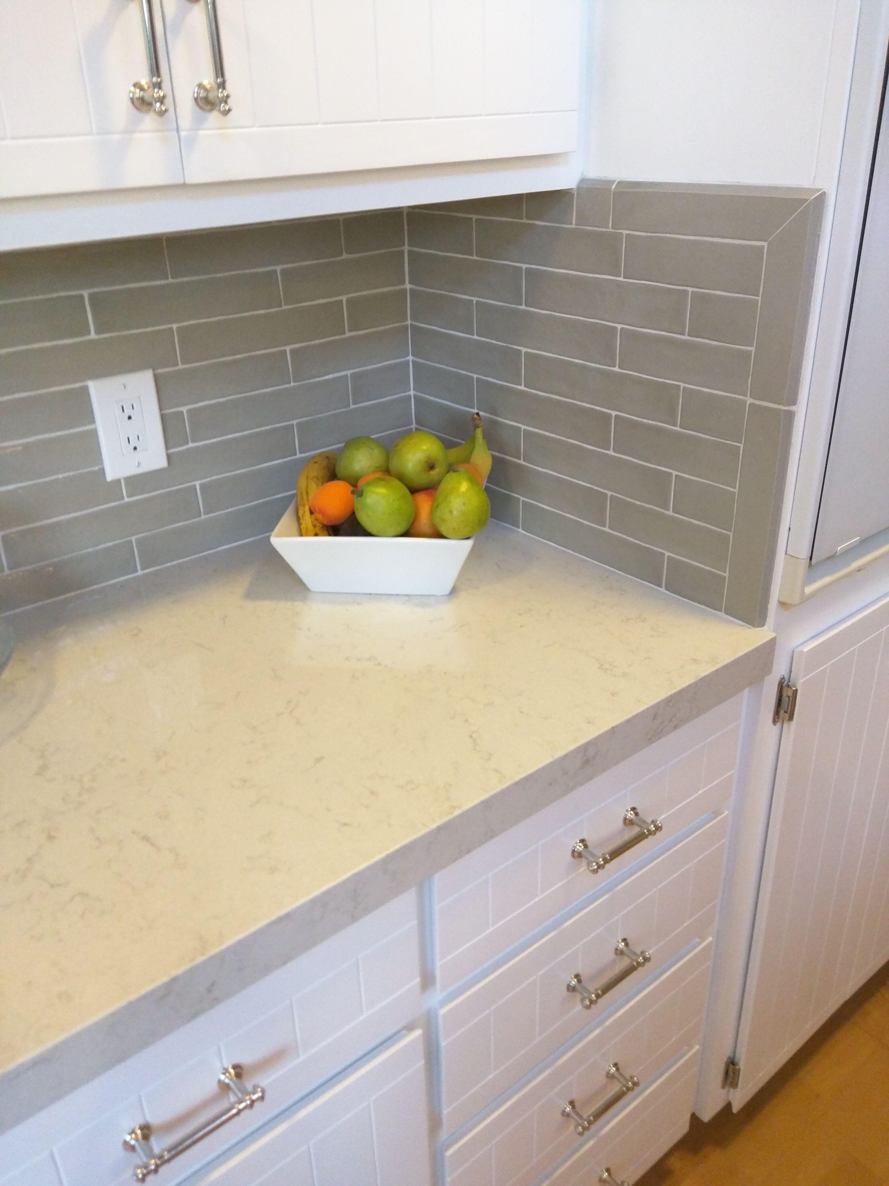 Counters: Hanstone Aspen Quartz; Backsplash: Agora Piastrella Sage Ceramic