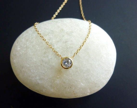 Tiny diamond look necklace in gold bezel set solitaire diamond tiny diamond look necklace in gold bezel set solitaire diamond look necklace diamond cz mozeypictures Image collections