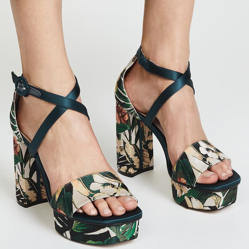 d91e97e160 These Stuart Weitzman platform sandals offer a retro-inspired silhouette  and a lush tropical pattern. This pair will elevate any look from polished  ...