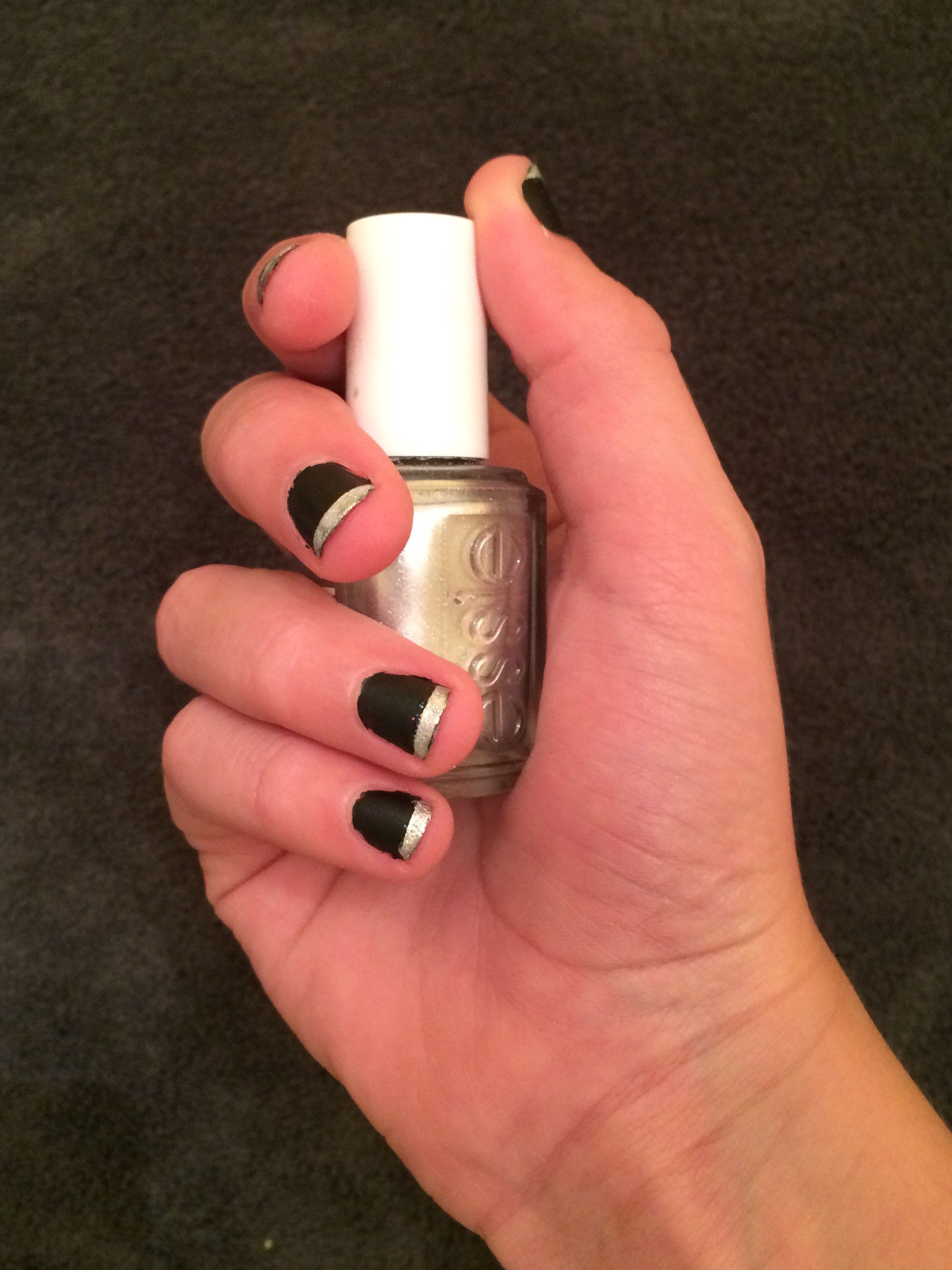 A matte black nail with a silver french tip. Difficulty: Medium ...