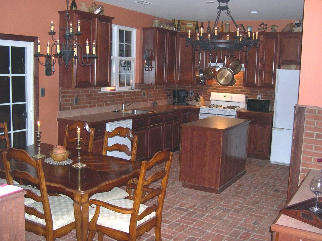Dining room brick veneer back splash ways our customers have kitchen wall and floor wrights ferry brick tile laid on the floor in basketweave pattern marietta color mix on the wall lancaster running bond brick dailygadgetfo Images