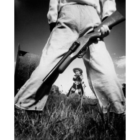 Two boys having a toy gun duel in a field Canvas Art - (18 x 24)