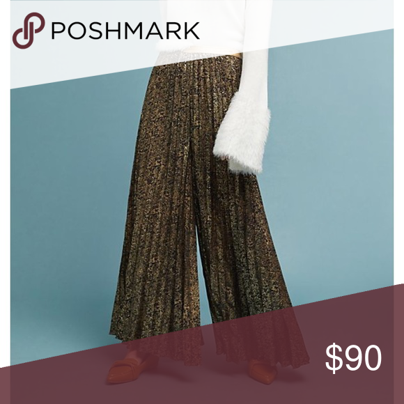 New Anthropologie Black Gold Pleated Pants #054 Liven up your work wardrobe by donning a bold black & gold metallic print, like the one found on these dramatically pleated, wide-leg trousers. •Polyester •Pleated detail •Wide-leg silhouette •Pull-on styling •Dry clean •27.75